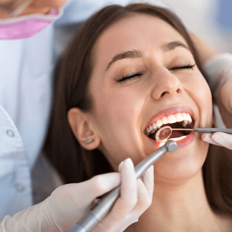 Woman at the dentist having teeth extraction procedure