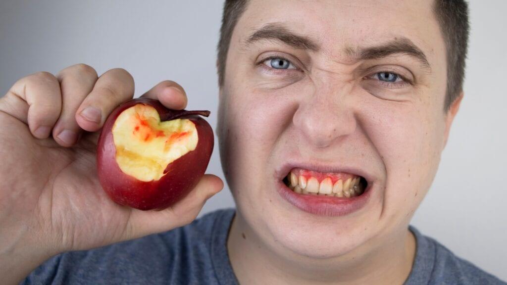 Man eating apple